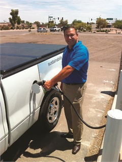 Brad Nemeth, ThyssenKrupp's director of sustainability helps fill a propane autogas pickup truck during a recent company drop off. Nemeth was hired in 2009 to implement the U.S. operation's sustainability objectives.