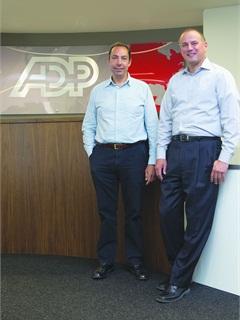 Michael Bieger, senior director of global procurement for ADP (right) and Hugo Del Mar, senior director global procurement for ADP in Hungerford, United Kingdom, work together overseeing the company's fleet.Photo Mark Ja Worski