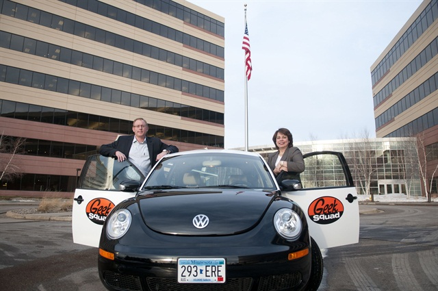 """(Left) Best Buy's Jason Pucely, senior manager of logistics & transportation, and Rosa Baumanis Hakala, VP, supply chain - transportation, stand with one of the """"GeekMobiles,"""" a black and white Volkswagen Beetle, one of the key icons of the company's brand."""