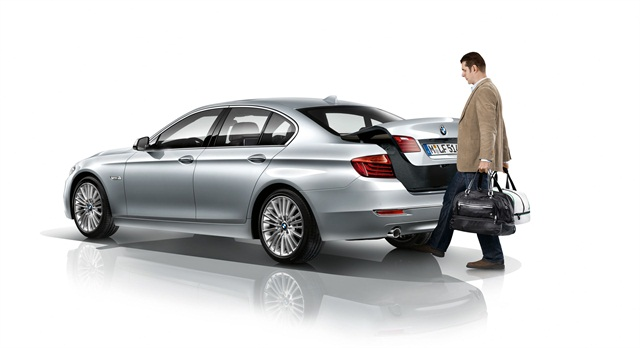 The sedan's Comfort Access feature, which allows a user to open the trunk by waving their foot under the rear apron, now can close via the same method. Photo courtesy BMW.