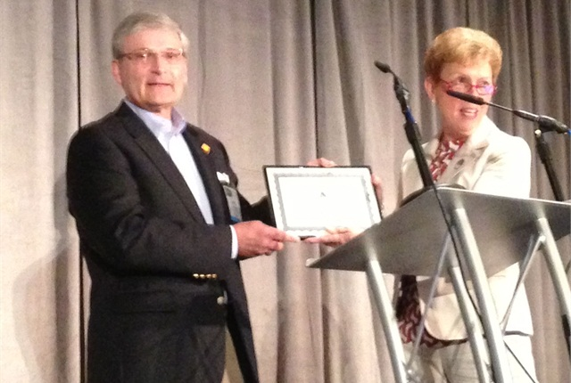 The Network of Employers for Traffic Safety's Executive Director Jack Hanley accepts the second annual Fleet Safety Award on behalf of Sandra Lee, director, worldwide fleet safety, for Johnson & Johnson. AALA's Executive Director Pam Sederhold (right) was on hand to present the award, as was Wheels Inc.'s President Dan Frank (not pictured). Photo by Chris Wolksi.