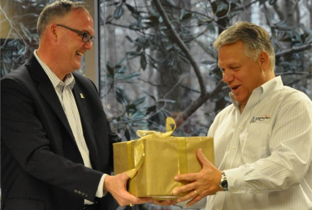 Ed Peper (left) presents a crystal bowl to Mike Pitcher.