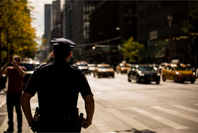 New York Police Department's Traffic Enforcement Agents will be on hand to enforce moving and parking violations, double parking, and off-route trucks as the city experiments with curbside delivery restrictions to help ease traffic. Photo via NYC Office of the Mayor.