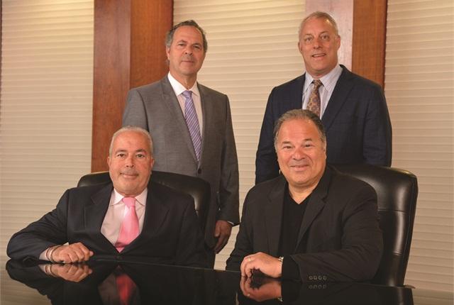 Merchants' owners (clockwise from upper left) Jeffery Singer, Michael Sydney, Gary Singer, and Robert Singer