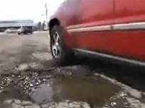 Video Safety Tip: Dealing With Potholes