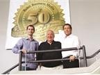 Ed, Ty, and Blake Bobit celebrating Bobit Business Media s 50th