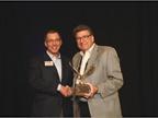 Dan Kennedy (left), retiring General Motors remarketing manager,