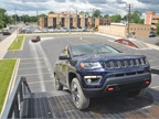 The Jeep Compass ascends a steep hill.