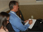 Attendees busily took notes during the presentations, including