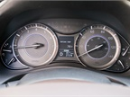 A traditional mostly non-digital gauge cluster includes a display that