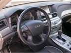 The interior includes amenities such as Japanese Ash wood trim and a