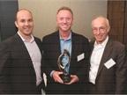 Congratulating William Davis, fleet & DOT manager, U.S, &