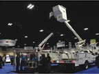 Altec s booth featured its fiberglass mechanics truck (left) and AT40G