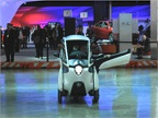 A single seat concept vehicle from Toyota zipped around a basketball