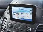 An available 6.5-inch touchscreen shows infotainment data.