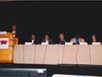Virgil Matczak of Dealers Auto Auctions (at Podium) moderated an