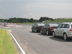 Vehicles line up to drive the Kick Plate, which tests a driver s