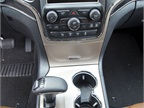 A center console dial shifts between rear-wheel and four-wheel modes.