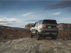 The Discovery perched on a rock hill in the desert near the