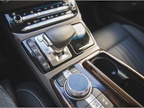 The G90 uses a joystick-style electronic shifter and multimedia