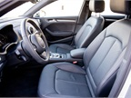 A 12-way power adjustable driver s seat includes leather surfaces.